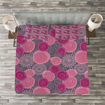 pink and grey quilted bedspread and pillow